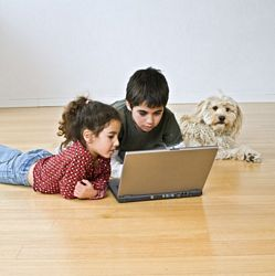 young children using a laptop